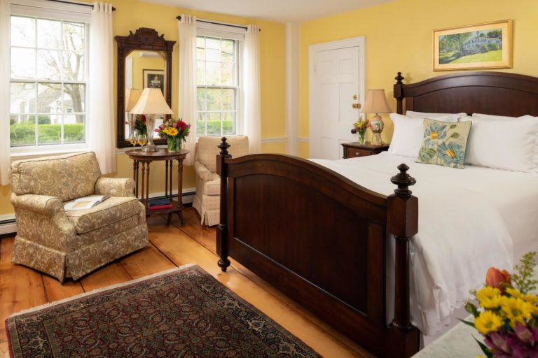 yellow room with bed and windows