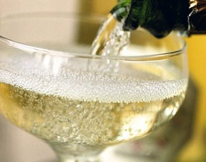 champagne being poured into glass