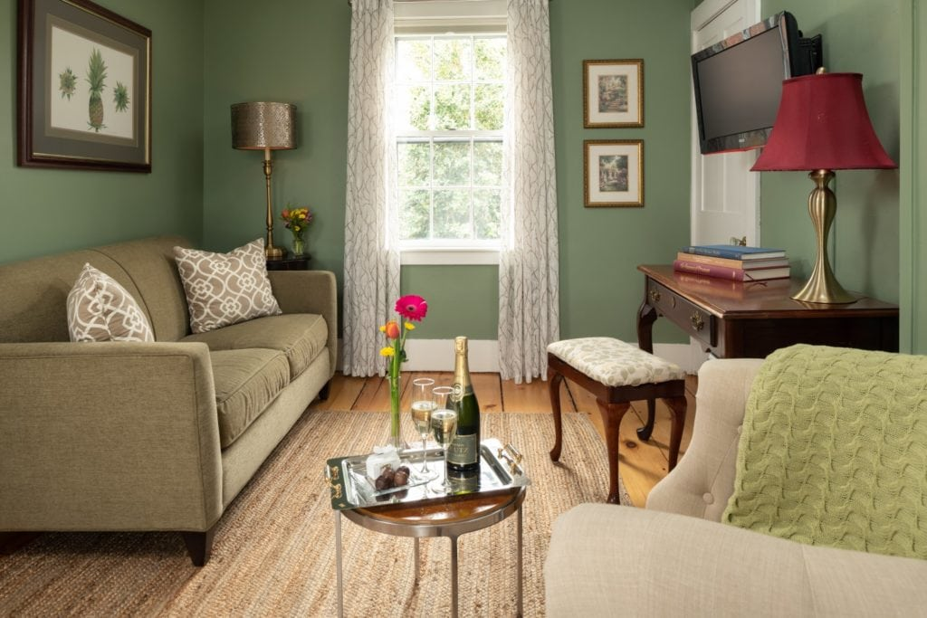 Couch and coffee table in the Seacroft Suite at Candleberry Inn.