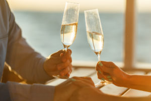Couple cheersing to staying at one of the best places to stay for couples on Cape Cod.