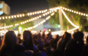People at an outdoor concert at night