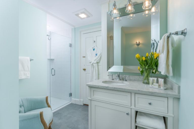 Standing shower with glass door and bathroom sink in Crickett room atlocal Cape Cod Bed and Breakfast