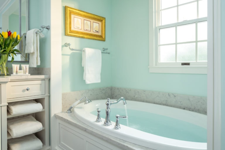 Large bathtub with frosted window at Candleberry Inn Cape Cod Bed and Breakfast