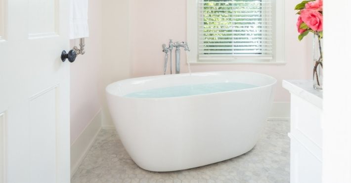 Soaker tub at Candleberry Inn with open inviting door - Amenities Cape Cod Bed and Breakfast