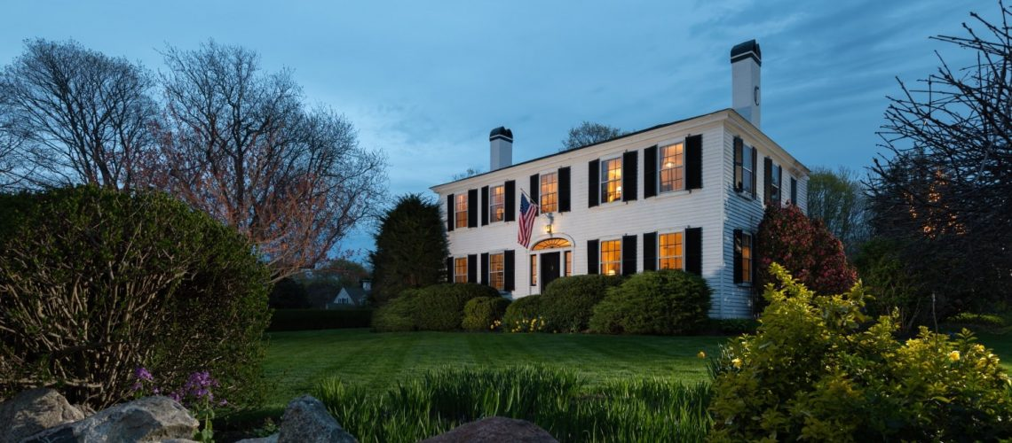Exterior view of Candleberry Inn at twilight.